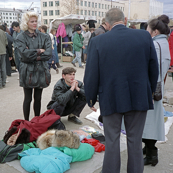 Ed wanted to buy a fur hat, so Maya took us to a market. Here we see Ed bargaining with some New Russians.