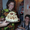 Yevgeny hosted Ed and me, and others from the Yakuti delegation for a wonderful dinner. Here Lidia, his wife, presents the wonderful cake that she made and decorated by hand. In the background are his teenaged son and 10-year old daughter.