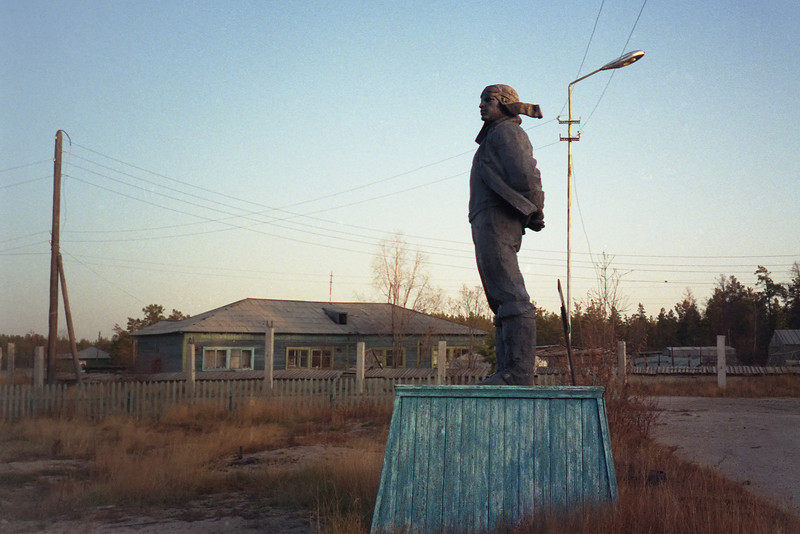 "A statue that my colleague Ed Rich and I dubbed ""The Last of the Yakuti Airmen"". It depicts a Yakuti flyer solemnly surveying the somewhat desolate landscape not far from the Hotel Ontario. It seems an unlikely location for a public memorial, so it may be a private one. The base is wood."