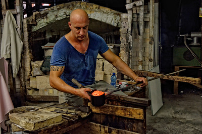 A glass blower in Murano, Italy