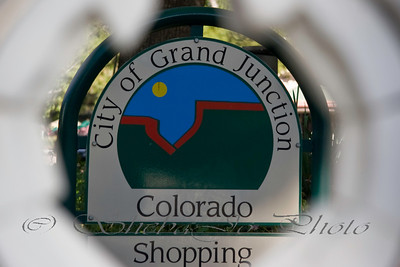 GJCO sign through Art on the Corner Statue