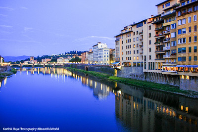 South bank of River Arno with the Ponte alle Grazie bridge, Florence, Italy