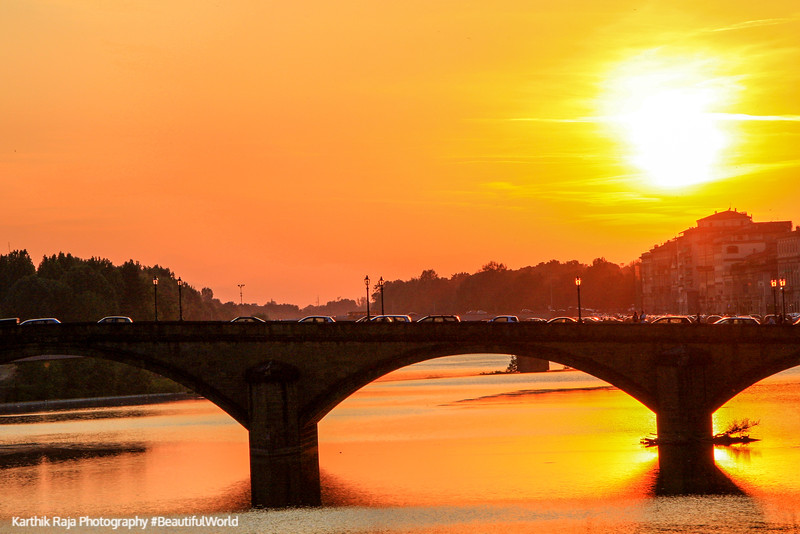 Ponte Santa Trìnita bridge across river Arno, Sunset, Florence, Italy