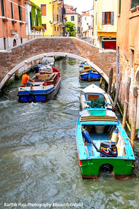 Canal, bridge and boat, Venice, Italy