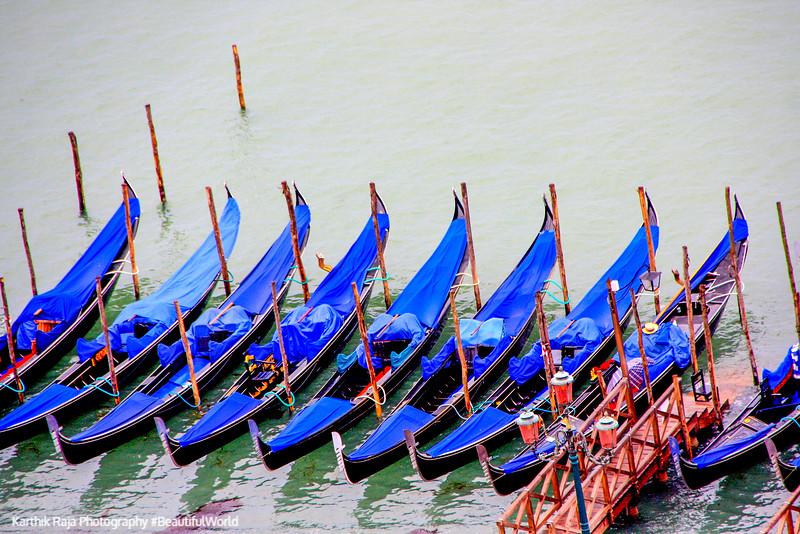 Gondolos waiting their turn, Venice, Italy