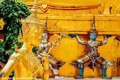 Statue of a kinnari with a rose in Wat Phra Kaew, Grand Palace