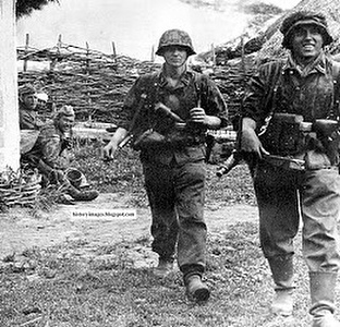 Two Waffen SS Soldiers during the Battle of Kursk, 1943, and a Russian POW in the background.<br /> #ww2 #wwii #ss #waffenss #german