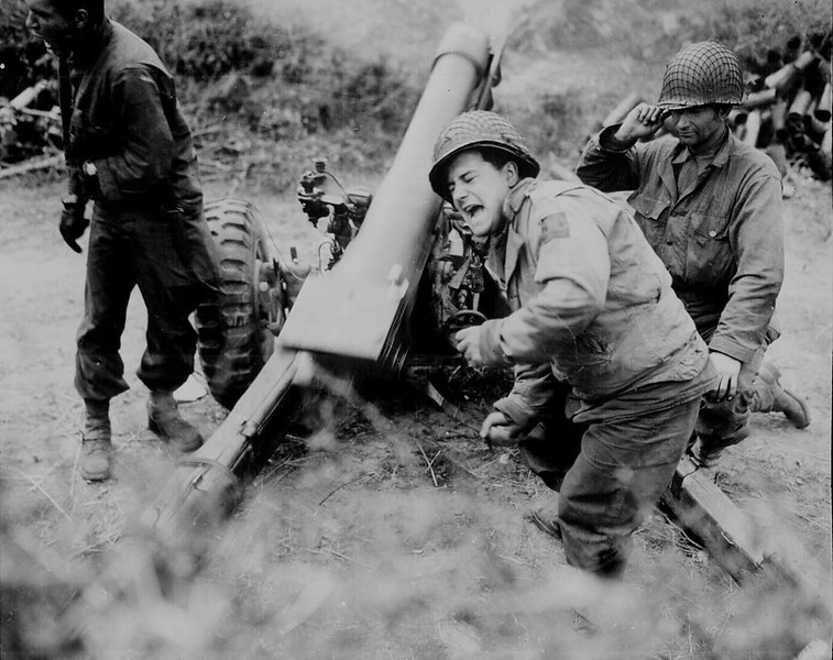 American soldiers with a howitzer gun firing on the Germans close to Carentan, Normandy, June 11, 1944. #ww2history #WW2 #WWII