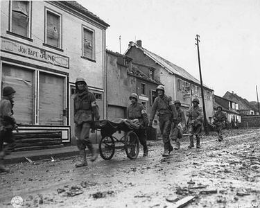 Medical personnel transport wounded back to the aid station, 1944. #ww2 #ww2history #paratrooper #1944