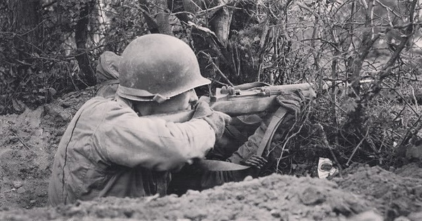 An American Soldier firing his M1 Garand. You can even see a pack of Lucky Strike cigarettes. #wwii #ww2 #ww2history