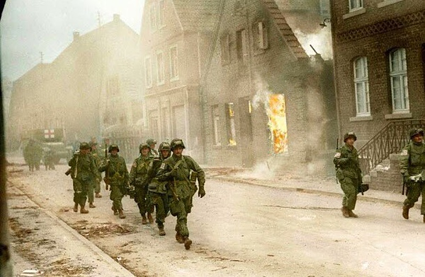 Men of the 17th Airborne march past a burning house in Appelhülsen, Germany. They are advancing towards the city of Münster. #ww2 #wwii #ww2history #paratrooper