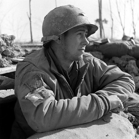 Medic, Pvt. E. Armitage, from Massachusetts, appreciates the sunshine after the long winter months peeking out of his foxhole, Anzio, 1944. #WW2 #ww2history #WWII