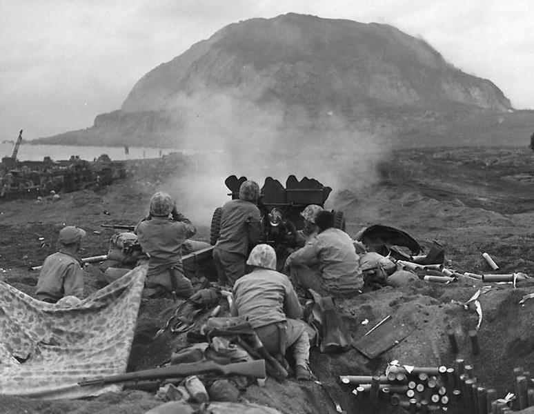 US Marines firing on Japanese emplacements on Mt. Suribachi, Iwo Jima, 1945. #ww2 #wwii #usmc #ww2usmc #ww2history