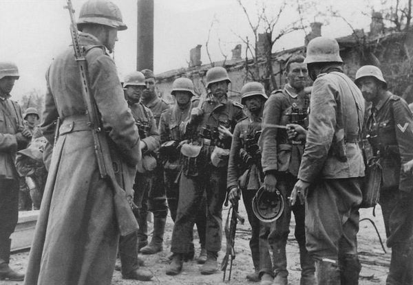 Some German soldiers and notice one is carrying a Soviet SVT40. #ww2 #wwii #ww2history