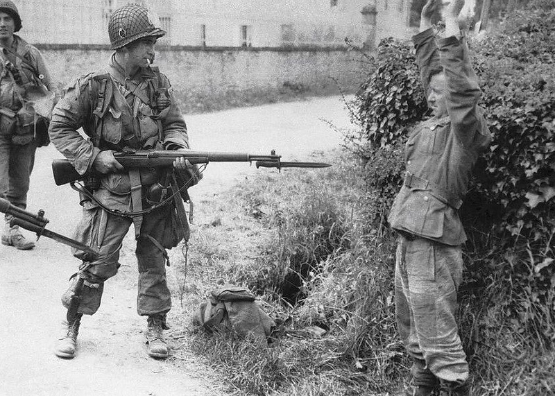 A German soldier surrendering to a US Paratrooper on D Day. #ww2history #dday #wwii #ww2 #paratrooper