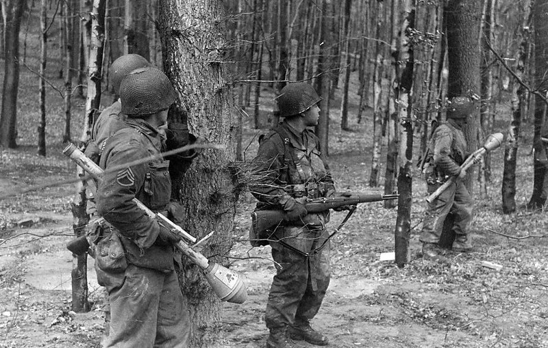 A group of American soldiers in a forest two soldiers are carrying captured German Panzerfausts, late 1944 or early 1945. The Panzerfaust is a hand held, single shot anti tank weapon. Despite some of its cons, the panzerfaust, when used properly can be a very deadly weapon for which the American tanks were not ready for. #WWII #ww2history #WW2