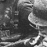 German soldier getting a light from a flamethrower. I guess if you don't have a lighter, a flamethrower will work😂. #ww2 #german #wwii