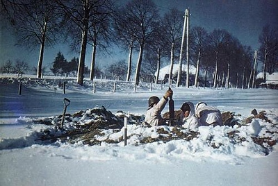 An American mortar crew of the  48th Infantry Battalion, 7th Armored Division, dug in on the snow-covered ground near St. Vith. Most likely January of 1945. The battle of St. Vith lasted from Dec. 16, 1944 to Dec. 21, 1944. The town of St. Vith was important because it was a vital road junction and it was as important to the Americans as it was to the Germans. #WW2 #ww2history #WWII #battleofthebulge