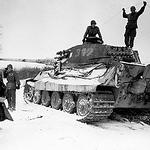 Two Allied soldiers inspect a German Tiger Tank, Belgium 1944.  #wwii #ww2 #tiger #tigertank #ww2history