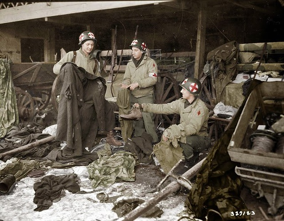 US Medics going through some gear, 1944. Also, thanks for 100 followers!! #ww2 #wwii #medic #ww2history