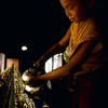 Monk lighting butterlamps - by Mannie Garcia