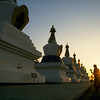 Palyul Namdroling, S. India - Stupas at sunset - by Mannie Garcia