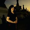 Jetsunma Ahkon Lhamo with Stupas at sunset at Palyul Namdroling - by Mannie Garcia