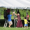 Lama's and Lay Sangha putting up tent for end of retreat activities