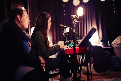 Emily and Kristen singing.