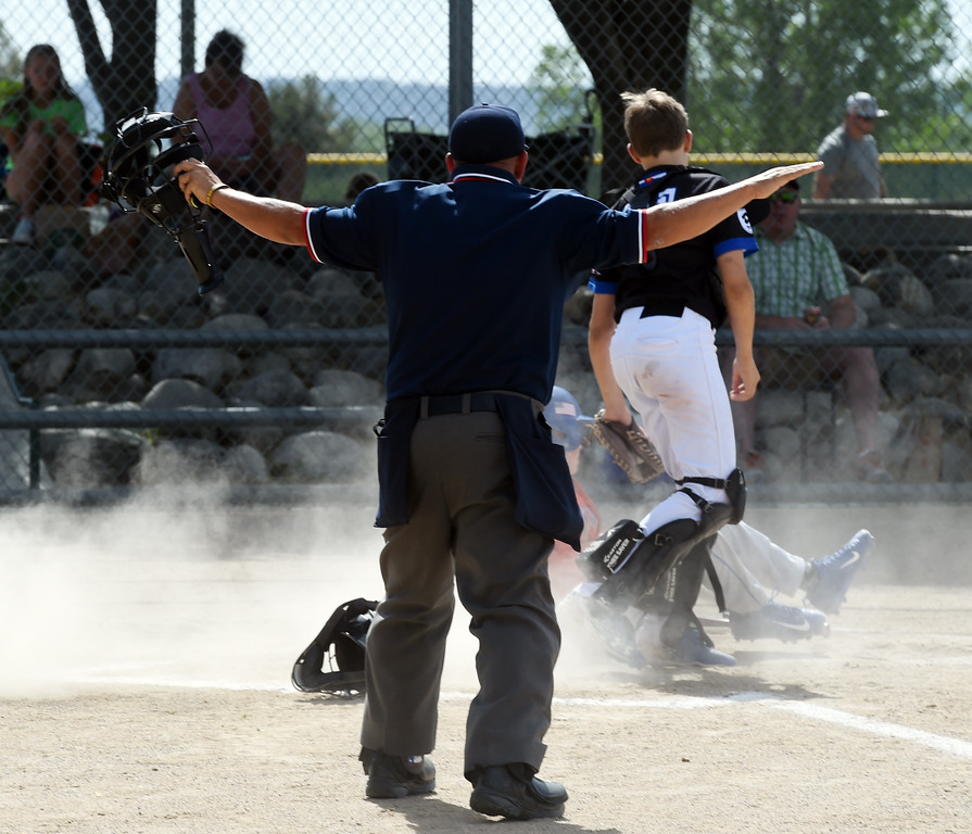 . Umpire, Jack Stanfield, calls the play safe at home.  Members of  the Wounded Warrior Umpire Academy worked a Little League tournament in Louisville on Saturday.For more photos, go to www.dailycamera.com.  Cliff Grassmick  Staff Photographer June 17, 2017