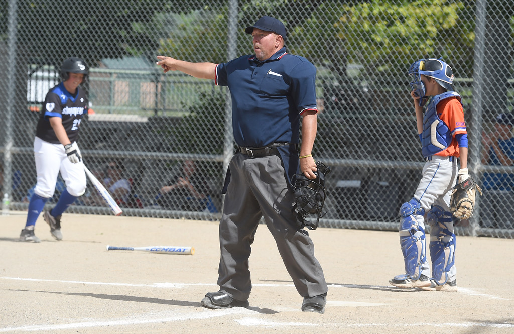 . Umpire, Jack Stanfield, calls the play fair from home. Members of  the Wounded Warrior Umpire Academy worked a Little League tournament in Louisville on Saturday.For more photos, go to www.dailycamera.com.  Cliff Grassmick  Staff Photographer June 17, 2017