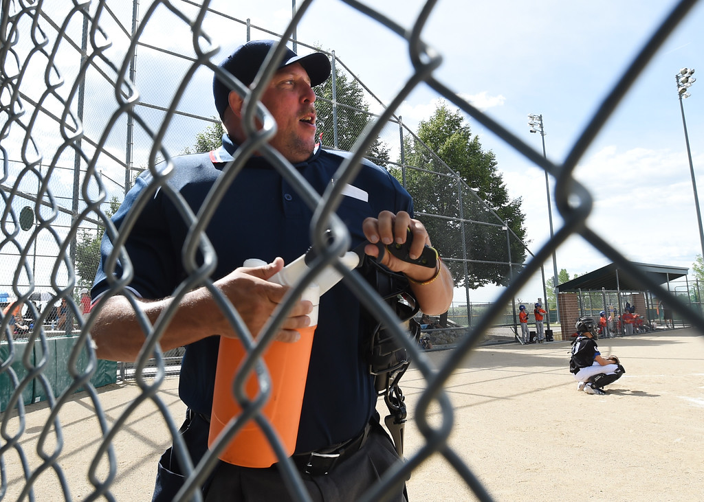 . Umpire, Jack Stanfield, gets a drink between innings.  Members of  the Wounded Warrior Umpire Academy worked a Little League tournament in Louisville on Saturday.For more photos, go to www.dailycamera.com.  Cliff Grassmick  Staff Photographer June 17, 2017