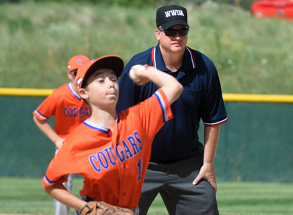 . Infield umpire, Chris Thomas, watches Quinn Kulesa, of the Denver West Cougars, pitch against the Slammers Q team.  Members of  the Wounded Warrior Umpire Academy worked a Little League tournament in Louisville on Saturday. For more photos, go to www.dailycamera.com.  Cliff Grassmick  Staff Photographer June 17, 2017