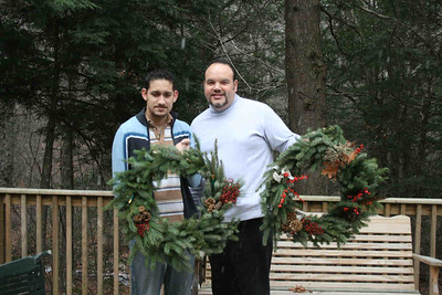 John and Dave used the feathers and shotgun shells along with the traditional pinecones and berries to adorn their spruce wreaths.