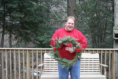 Mike added some small bows, a gold ball and a HOHOHO to his wreath of white pine and spruce.