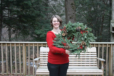 Valerie and I stuck with the traditional spruce wreath covered in pinecones and red berries for a very festive look.