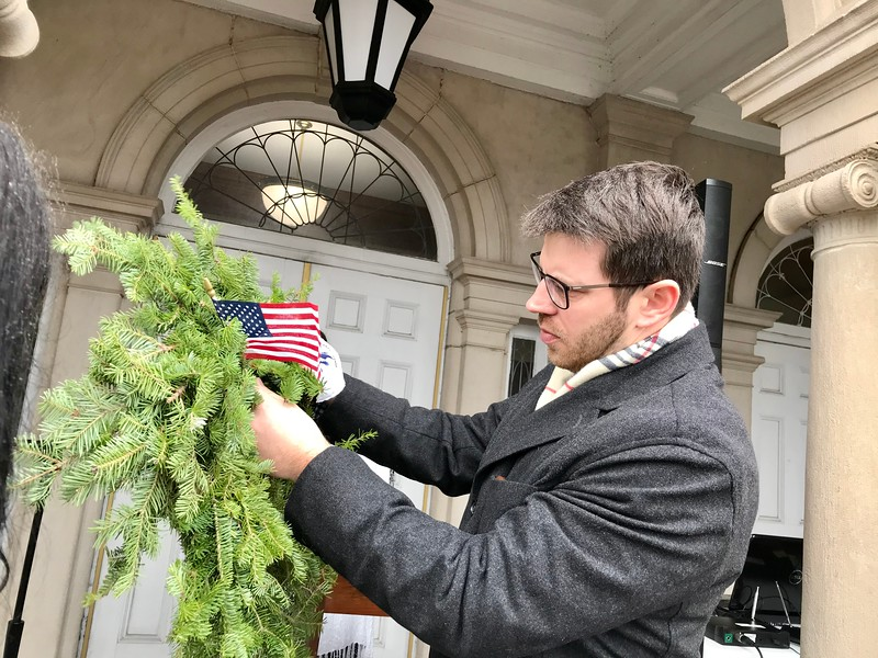 Billerica Veterans Agent Joe Ruggiero put the finishing touches on a wreath before the Wreaths Across America ceremony on Dec. 14. Photo by Mary Leach