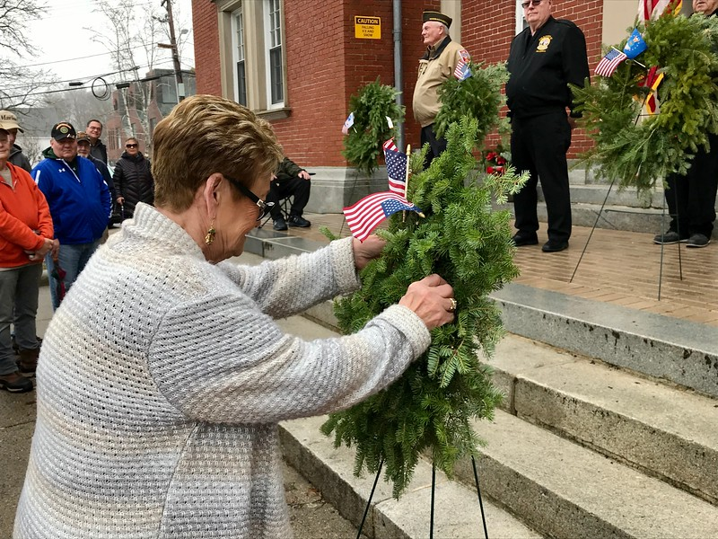 Marie O'Rourke of the Billerica Veterans Office placed the past wreath in honor of the late Ken Buffum, who passed away this year. Photo by Mary Leach
