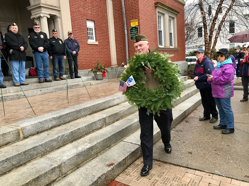Bill Meehan placed the wreath to honor U.S. Army veterans during the ceremony on the Billerica Public Library steps. Photo by Mary Leach