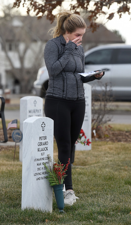 . BROOMFIELD, CO - December 15, 2018: Annie Klauck becomes emotional at her father\'s grave at the Broomfield County Commons Cemetery on December 15, 2018. The Broomfield Rotary Club held a wreath-laying ceremony at Broomfield\'s two cemeteries. Wreaths are meant to honor veterans in all branches throughout the holidays. For more photos, go to dailycamera.com.  (Photo by Cliff Grassmick/Staff Photographer)