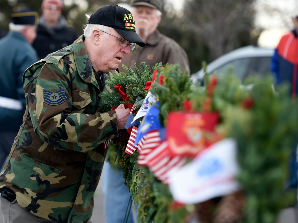 . BROOMFIELD, CO - December 15, 2018: Bob Erichsen, a Merchant Marine Vet, puts a wreath up to honor his military branch at the Broomfield County Commons Cemetery on December 15, 2018. The Broomfield Rotary Club held a wreath-laying ceremony at Broomfield\'s two cemeteries. Wreaths are meant to honor veterans in all branches throughout the holidays. For more photos, go to dailycamera.com.  (Photo by Cliff Grassmick/Staff Photographer)