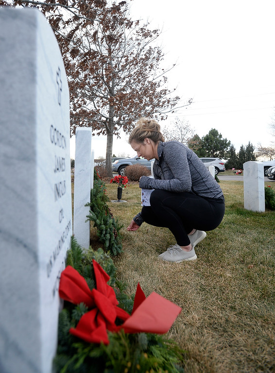 . BROOMFIELD, CO - December 15, 2018: Annie Klauck, puts down wreaths at veteran grave sites at the Broomfield County Commons Cemetery on December 15, 2018. The Broomfield Rotary Club held a wreath-laying ceremony at Broomfield\'s two cemeteries. Wreaths are meant to honor veterans in all branches throughout the holidays.  (Photo by Cliff Grassmick/Staff Photographer)