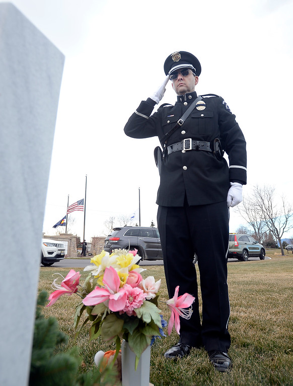 . BROOMFIELD, CO - December 15, 2018:  Drew Wilson, of the Broomfield Police Department, salutes a veteran\'s grave at the Broomfield County Commons Cemetery on December 15, 2018. The Broomfield Rotary Club held a wreath-laying ceremony at Broomfield\'s two cemeteries. Wreaths are meant to honor veterans in all branches throughout the holidays.  (Photo by Cliff Grassmick/Staff Photographer)