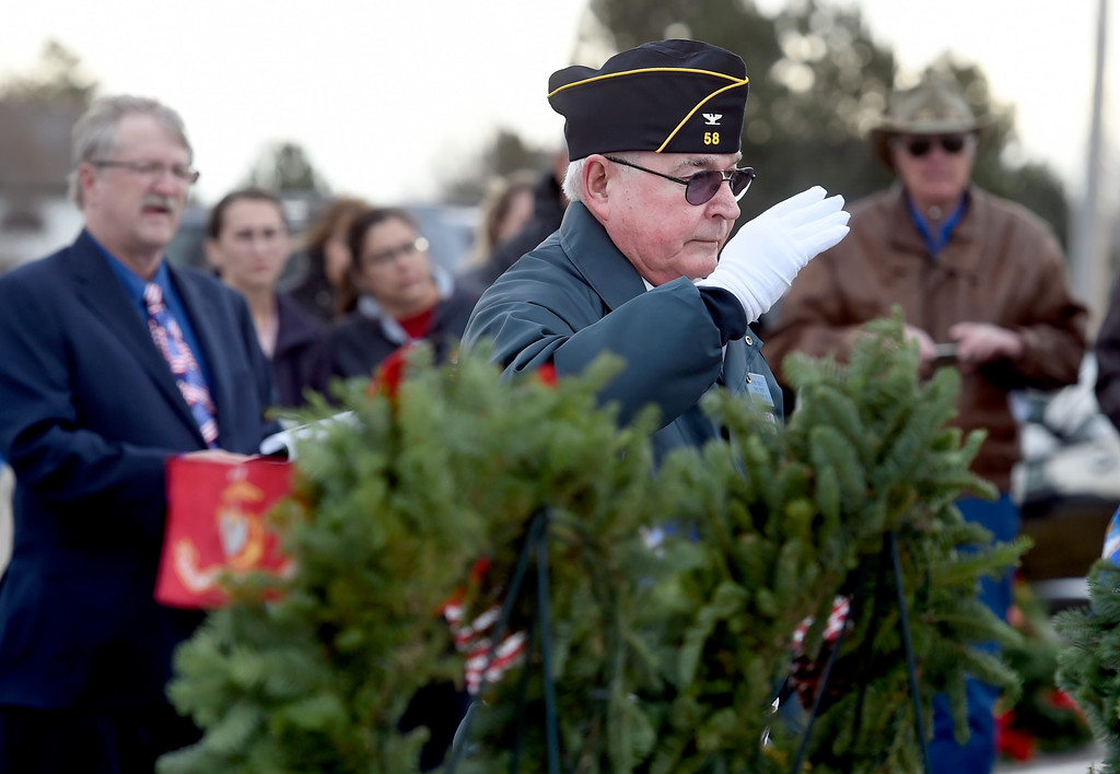 . BROOMFIELD, CO - December 15, 2018: Patrick Crotty, a Coast Guard veteran, salutes the wreath he put up at the Broomfield County Commons Cemetery on December 15, 2018. The Broomfield Rotary Club held a wreath-laying ceremony at Broomfield\'s two cemeteries. Wreaths are meant to honor veterans in all branches throughout the holidays. For more photos, go to dailycamera.com.  (Photo by Cliff Grassmick/Staff Photographer)