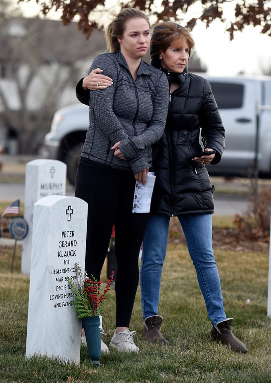 . BROOMFIELD, CO - December 15, 2018: Annie Klauck, left, is comforted by her aunt, Marty Paluch, at her father\'s grave at the Broomfield County Commons Cemetery on December 15, 2018. The Broomfield Rotary Club held a wreath-laying ceremony at Broomfield\'s two cemeteries. Wreaths are meant to honor veterans in all branches throughout the holidays. For more photos, go to dailycamera.com.  (Photo by Cliff Grassmick/Staff Photographer)