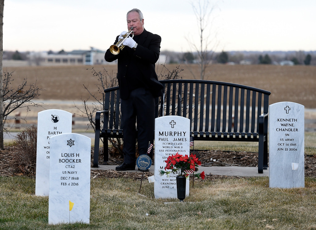 . BROOMFIELD, CO - December 15, 2018: Thomas Rudd, of Bugles Across American, plays at the Broomfield County Commons Cemetery on December 15, 2018. The Broomfield Rotary Club held a wreath-laying ceremony at Broomfield\'s two cemeteries. Wreaths are meant to honor veterans in all branches throughout the holidays. For more photos, go to dailycamera.com.  (Photo by Cliff Grassmick/Staff Photographer)