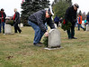 HOLLY PELCZYNSKI - BENNINGTON BANNER Army veteran Steve Greenslet of Bennington lays a wreath for a fellow brother during the wreaths across America event held on Saturday at the Vermont Veterans Home in Bennington Vermont.