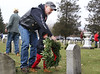 HOLLY PELCZYNSKI - BENNINGTON BANNER Veteran, Steve Betit of Poltney Vermont teaches his young 2 year old grandson John Davenport to lay a wreath on a gravesite of a veteran on Saturday morning at the Vermont Veterans Home in Bennington during the wreaths across america event.
