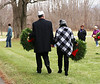 HOLLY PELCZYNSKI - BENNINGTON BANNER A couple walks around the grave sites at the Vermont Veterans Home looking to place their wreaths down for some fallen soldiers on Saturday morning during the wreaths across America event.