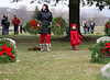 HOLLY PELCZYNSKI - BENNINGTON BANNER Jenna Ardia of Bennington looks for grave sites to place her wreaths along with her 3 year old daughter Eva Ardia on Saturday morning while at the Vermont Veterans Home during the wreaths across America event in Bennington.